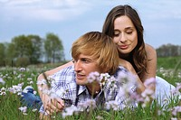 Young couple on a summer meadow