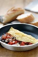 Tomato, ham and mushroom omelette