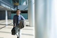 Businessman rushing through office lobby