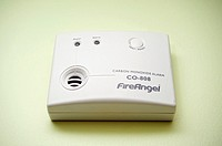 A carbon monoxide alarm fitted on an interior wall