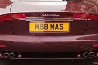 The back of a Maserati sports car with personalised number plate in the Uk