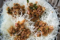 Thai fusion food, Spicy pork mince with herb top on crispy noodle Laab Rung Nok or mince pork with Bird nest