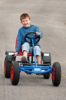 A  nine year old boy on a Berg go cart in the Uk