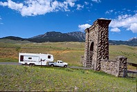 USA Wyoming Yellowstone National Park north entrance Truck with a camper trailer cruises