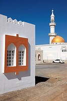 facade of a house with window and mosque with minaret in the village of Sur, Ash Sharqiyah Region, Sultanate of Oman, Asia