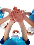 doctors with hands together to form a medical teamwork _ isolated over a white background