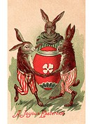 A vintage Easter postcard of three rabbits dancing around a painted egg