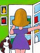 A woman looking in her fridge
