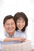 Couple, Wife bonding husband with arms around and smiling happily
