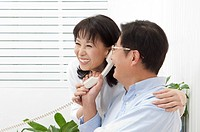 Couple, Couple holding telephone together and smiling happily