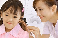 Young nurse making body care for little girl (thumbnail)