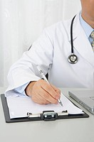 Doctor writing on the clipboard