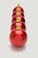 Red Christmas baubles in a row