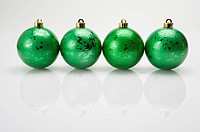 A row of green Christmas baubles