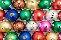 Rows of colorful Christmas baubles