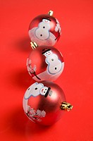 Three Christmas baubles with patterns of snowman