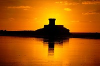 Sunset over La Rocco Tower, St Ouens Bay, Jersey, Channel Islands