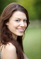 Portrait of a beautiful female smiling outdoors