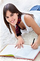 Beautiful woman studying at home and smiling