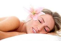 woman sleeping with a flower on her head