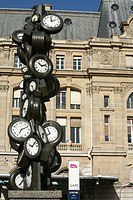 FACADE OF THE GARE SAINT LAZARE TRAIN STATION AND SCULPTURE ´THE CLOCKS´ BY THE ARTIST ARMAN, PARIS, FRANCE