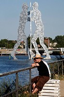 MOLECULE MAN BY THE AMERICAN JONATHAN BOROFSKY 1999 SYMBOLISES THE REUNION OF THE THREE DISTRICTS, KREUZEBERG TO THE NORTH, FRIEDRICHSHAIN ACROSS AND ...