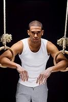 Gymnast man on Rings.
