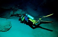 Diver in Cave with Turtle Skeleton, Pacific ocean Borneo Sipadan, Malaysia