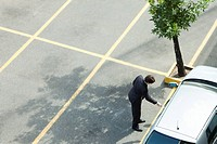 Businessman unlocking car door