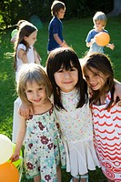 Childhood friends at outdoor party, portrait