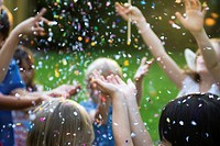Children showered in falling confetti (thumbnail)