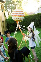 Children pulling streamers attached to pull string pinata