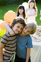 Young friends together at outdoor party, portrait