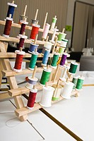 Spools of thread on rack (thumbnail)