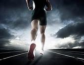 Black runner running on race track