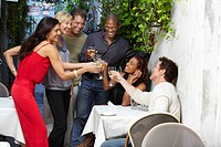 Friends toasting on restaurant patio