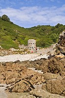 Petit Bot Bay FOREST GUERNSEY Seafront rocky beach bay and Loophole tower No13 18th Century defenses