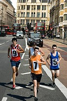 Runners on road in london