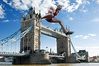 Hurdler going over tower bridge