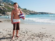 Boy on a beach with ball