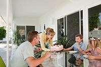 Family having birthday cake