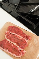 Raw steak on chopping board (thumbnail)