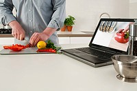 Man using laptop during cook along