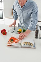 Man reading cook book