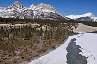 Canadian Rockies in spring with partly frozen river. Drive from Banff to Jasper near Calgary, Alberta, Canada