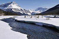 Canadian Rockies and partly frozen river in the Rocky mountains. Drive from Banff to Jasper near Calgary, Alberta, Canada