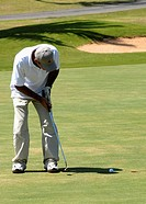 a young man playing golf in Varadero Golf Club