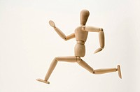 A wooden figure with the gesture of running