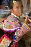 Child From The Flower Hmong Hill Tribe, Eating Noodles, Coc Li Market, Sapa, Vietnam