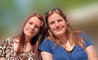 This stock photo are two young adult Caucasian brunette women both with long hair and smiling who are both sisters and friends They are in their early...